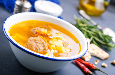 Soup with meat balls and vegetables, soup in bowl