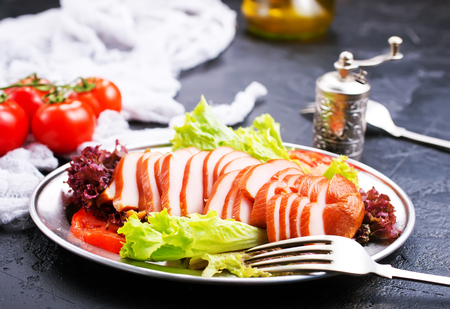 Smoked meat with fresh vegetables on plate