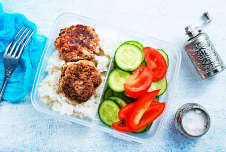 Rice with cutlets and vegetables in lunchbox