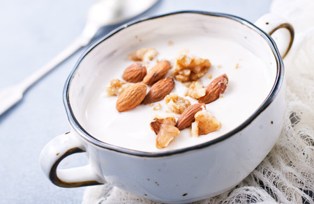 Sour cream with sugar and nuts, desert with nuts Stock Photo