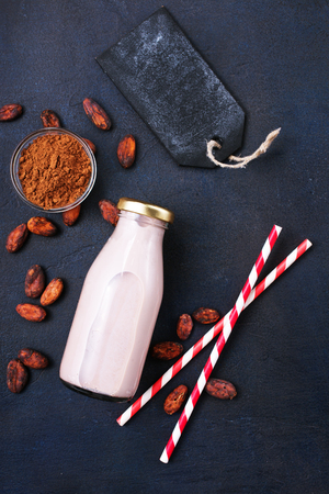 Drink in bottle, drink with milk and cocoa powder