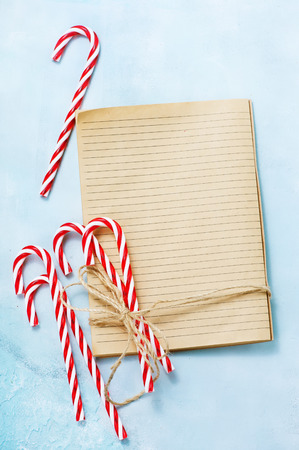 Christmas  book for recipe and candy canes Stock Photo