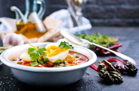 beet soup with boiled eggs, beet soup in bowl Фото со стока