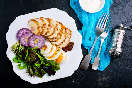 backed chicken fillet with white sauce on plate Stock Photo