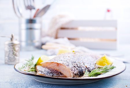 Fresh fish, raw cod fillets with rosemary and salt Фото со стока