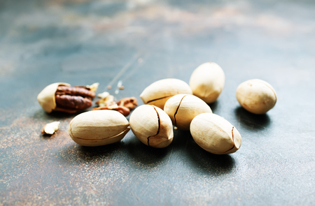 Pecan nuts on a table, pecan nuts in shell