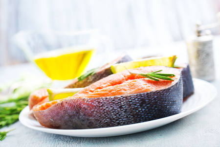 raw salmon steak with spice and oil