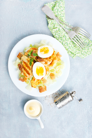 salad with fried chicken and boiled eggs Stock Photo