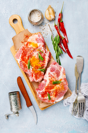 raw meat steak with salt and aroma spice