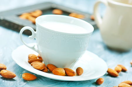 almond milk in cup and on a table Stock Photo