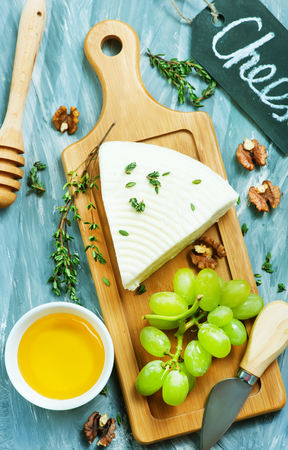 cheese with grape and walnuts on the board Stock fotó - 117517257