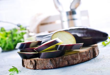 raw eggplant and knife on board, fresh eggplant 写真素材