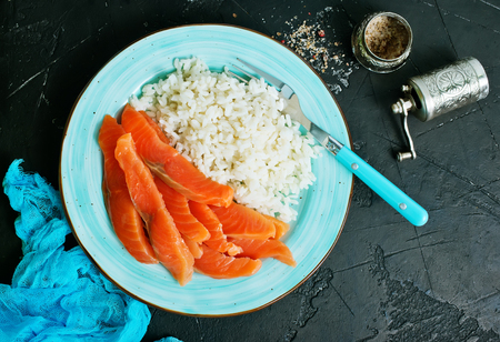 boiled rice with salmon on plate, diet food Stock Photo