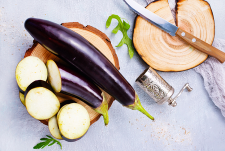raw eggplant and knife on board, fresh eggplant Stock fotó