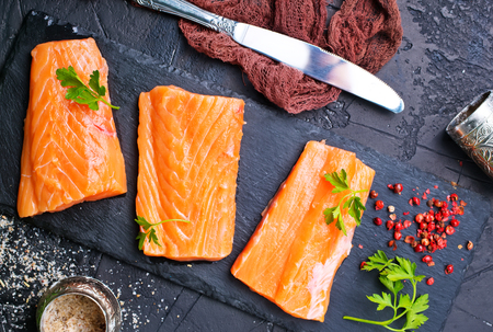raw salmon with spice and salt on board