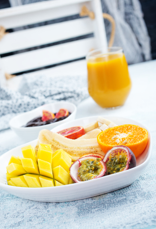 Healthy and fresh fruits on a plate Stock Photo - 118683278