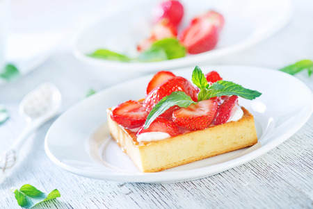 cake with strawberry on the white plate