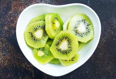 Still life image of sliced kiwi fruit on white plate Stock Photo