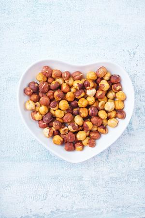 hazel nuts in white bowl, dry hazelnuts