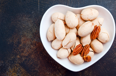 pecan in white bowl and on a table Stock Photo