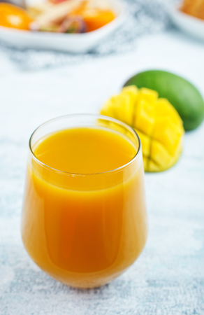 mango juice in glass, fresh juice and fruits