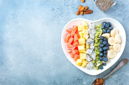 salad with fresh berries and fruits in bowl