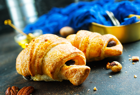 sweet croissant with chocolate and nuts, croissant for breakfast Standard-Bild