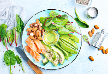 Healthy food antioxidant products: fish and avocado, nuts and fish oil Stock fotó