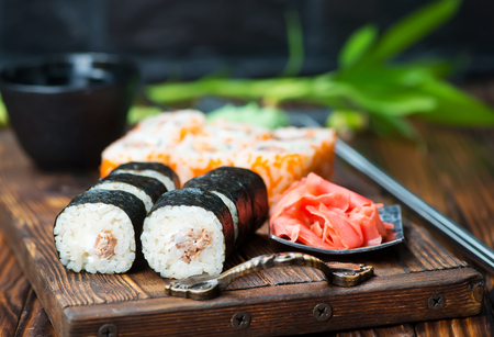 sushi with wasabi and ginger on a table Stock Photo