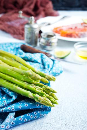 green asparagus on kitchen table, fresh asparagus
