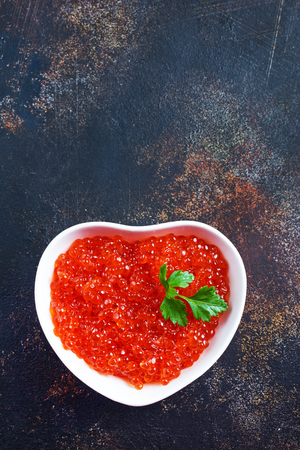 red caviar in white bowl, salmon caviar 스톡 콘텐츠