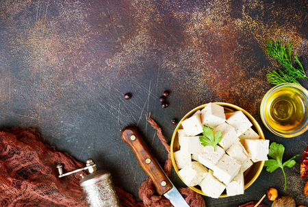 tofu cheese in metal bowl on a table Stock Photo