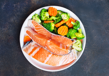 salmon with vegetable salad on white plate Stock Photo