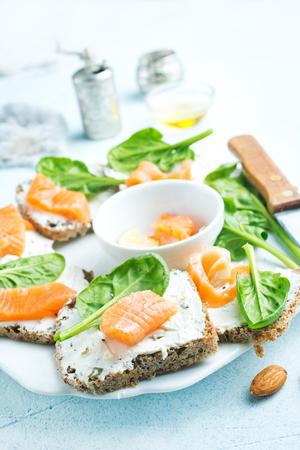 bread, cheese, salmon for breakfast on a table