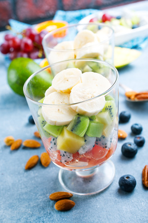 fruit salad in glass, fresh fruits and berries Stock Photo
