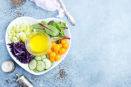 diet food, fresh vegetables and oil, ingredients for salad