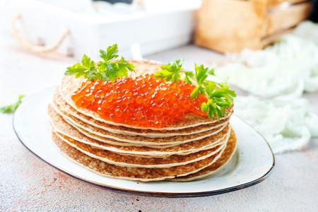 pancakes with red salmon caviar, fried pancakes