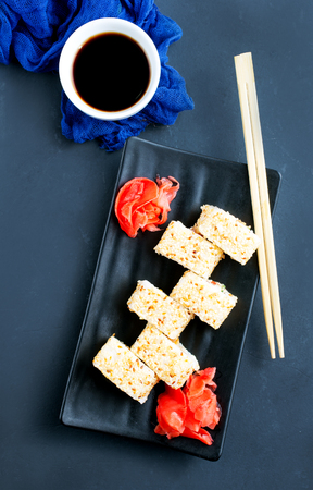 sushi with salmon and ginger on black plate Stock Photo
