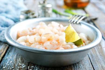 boiled shrimps with fresh lemon in bowl, diet food Stock Photo