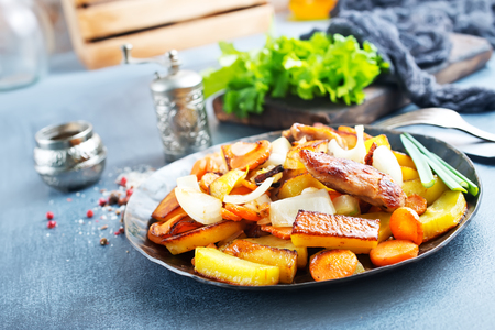 potato with meat on plate, fried potato with meat Banco de Imagens