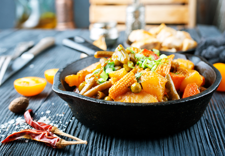 vegetable stew in pan, fried vegetables with oil and spice