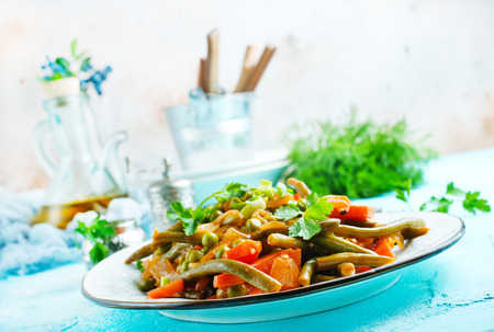 baked vegetables on plate, salad with fried vegetables