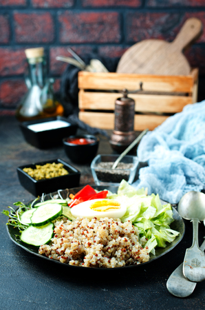 Healthy vegetarian salad with vegetables qinoa chickpea salad leaves. Healthy buddha bowl salad.