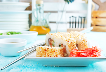 Delicious sushi rolls with rice, chuka and sauce