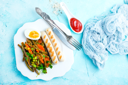 sausages and vegetables for dinner on plate