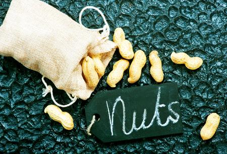 peanuts on the black background,k dry peanuts