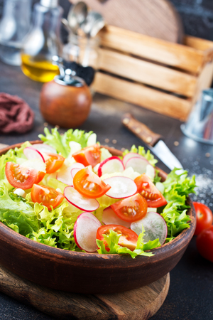 fresh vegetable salad on plate on a table