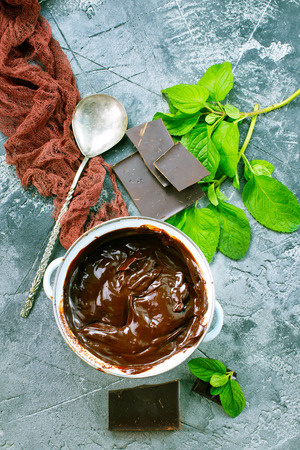 chocolate cream in bowl and on a table Stock Photo