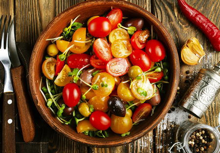 tomato salad with oil and olives in bowl 写真素材