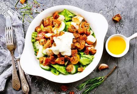 caesar salad, salad with grilled chicken on plate